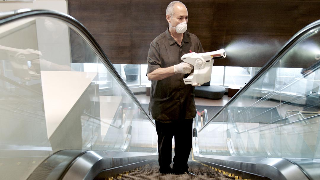 Man disinfecting the elevators at a Marriott International Hotel